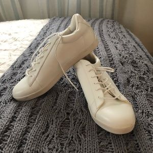 White flat sneakers
